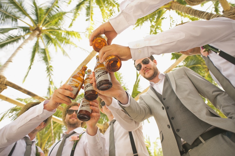 A groom and his friends toasting their new cigar selection from Havana House