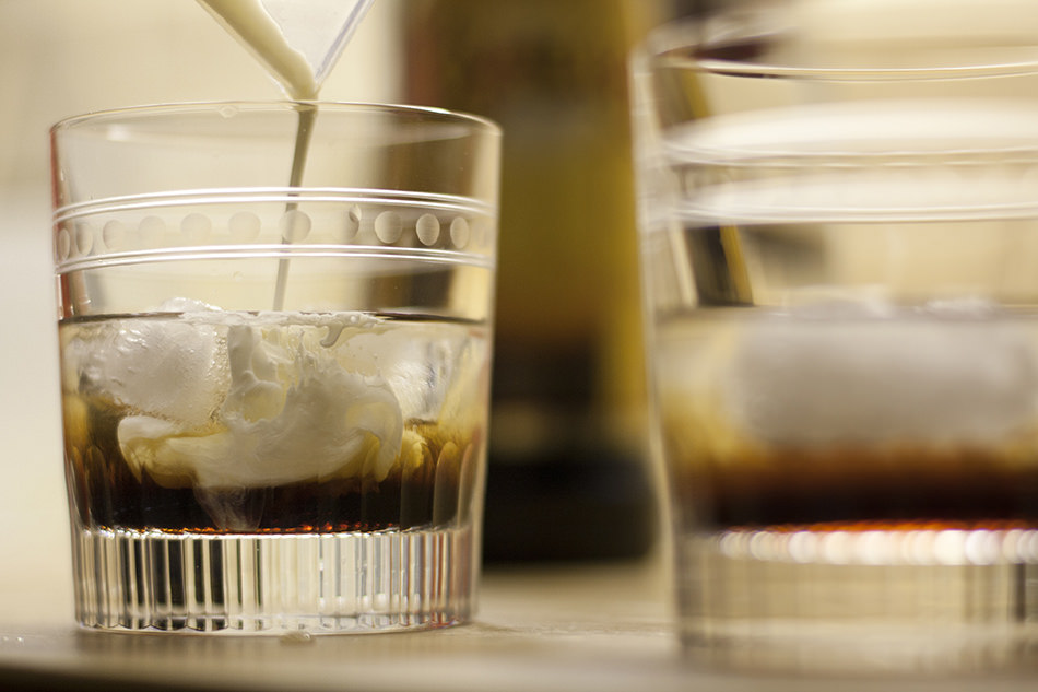 A white russian cocktail being made