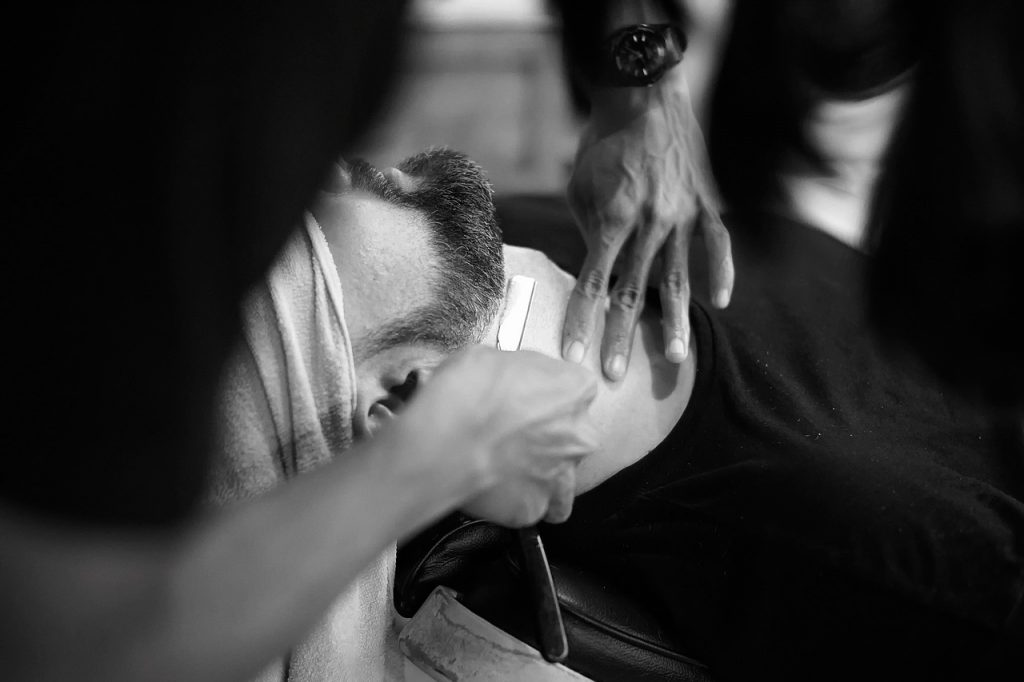 Man shaving using a Dovo straight razor