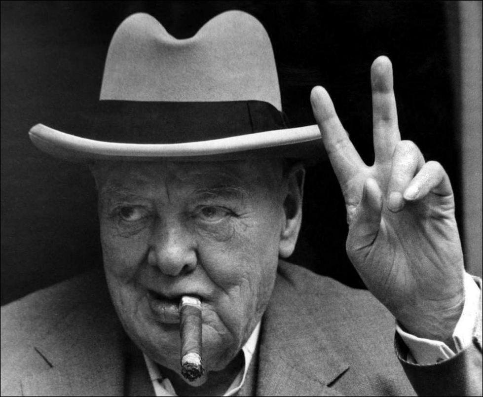 Winston Churchill, smoking a cigar.
