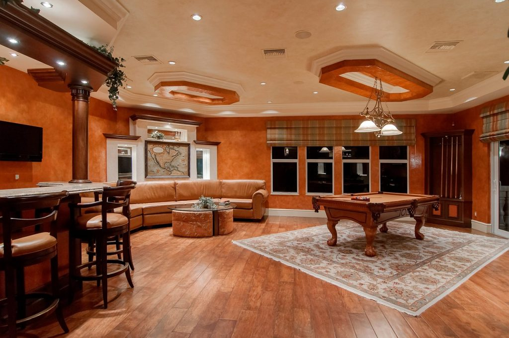 Man cave, complete with pool table and bar.