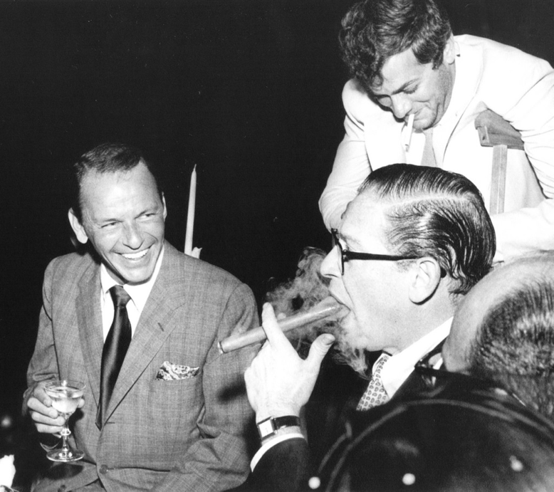 Frank Sinatra and friends enjoying cigars.