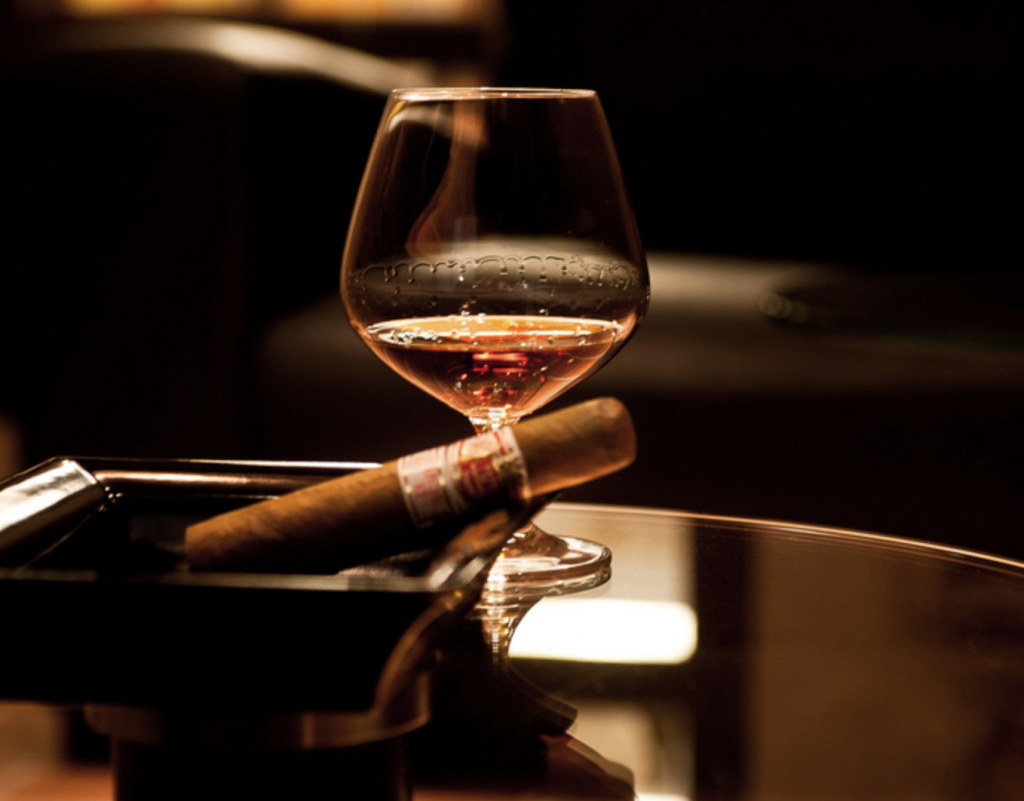 Cigar and cognac on table