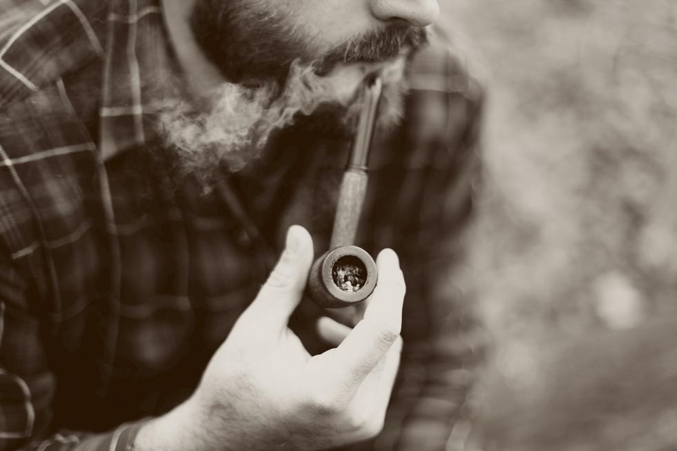 Man smoking a pipe.