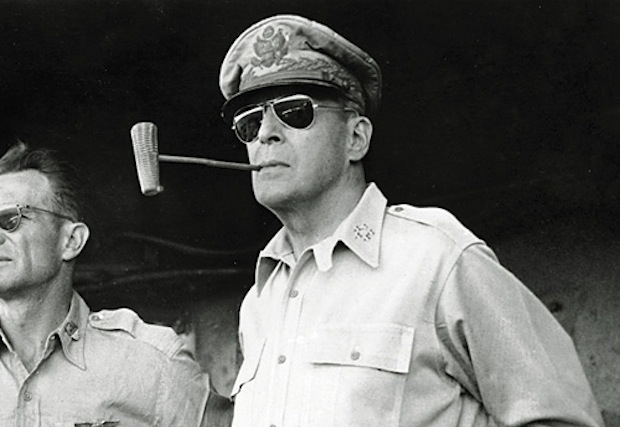 Douglas Macarthur smoking a corn cob pipe