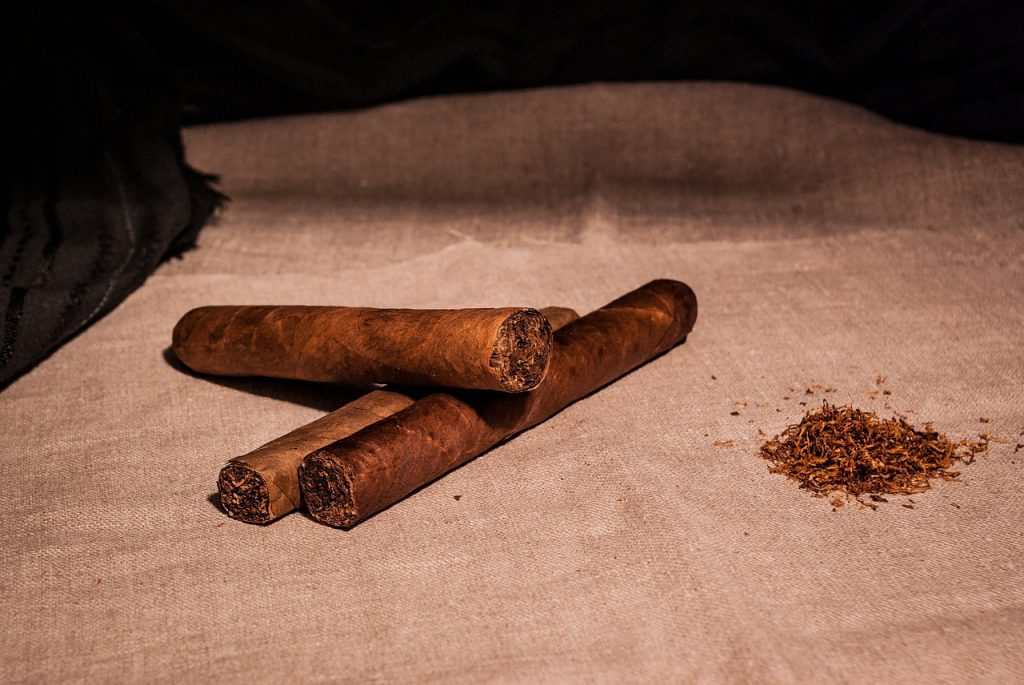 Three Cigars and tobacco