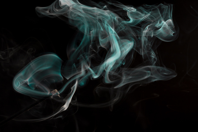 Smoke sifting through the air on a black background.