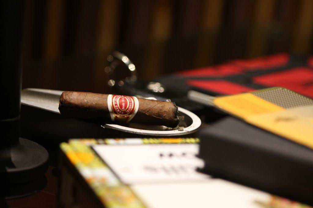 Burning cigar in an ashtray