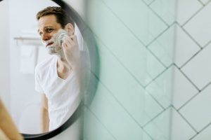 Man getting ready to shave with a dovo straight cut razor