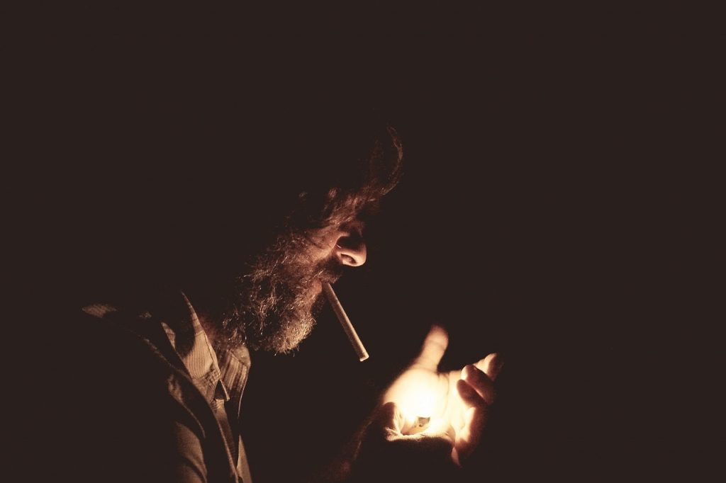 Man who is lighting a cigar