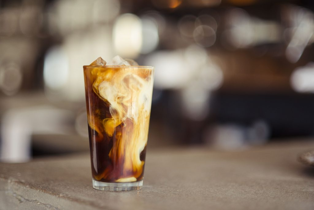 Coffee Trends: An iced coffee in a glass on a wooden table