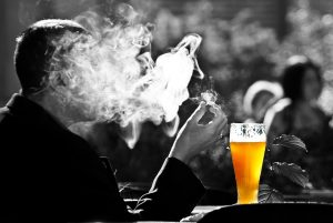 Smoking a cigar with a pint of beer