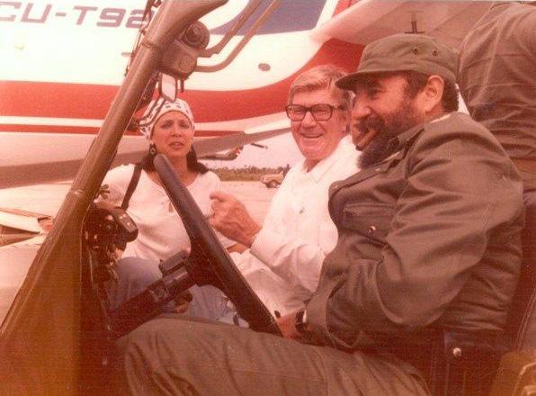 Fidel Castro with the head of Coca Cola