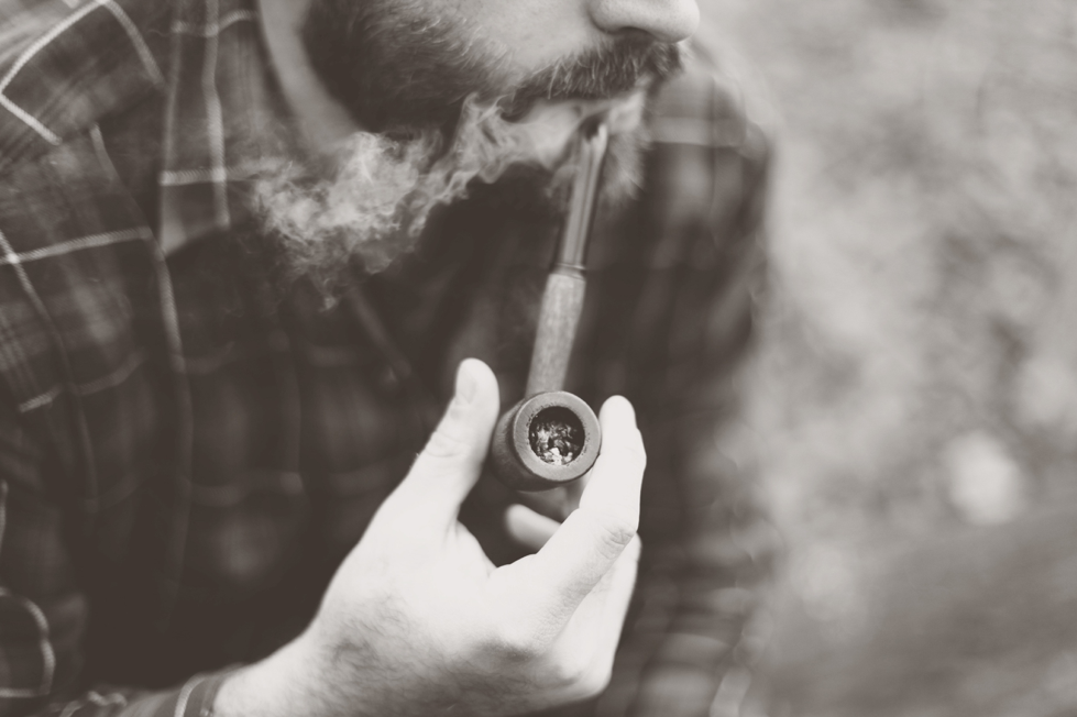Man smoking tobacco with a pipe