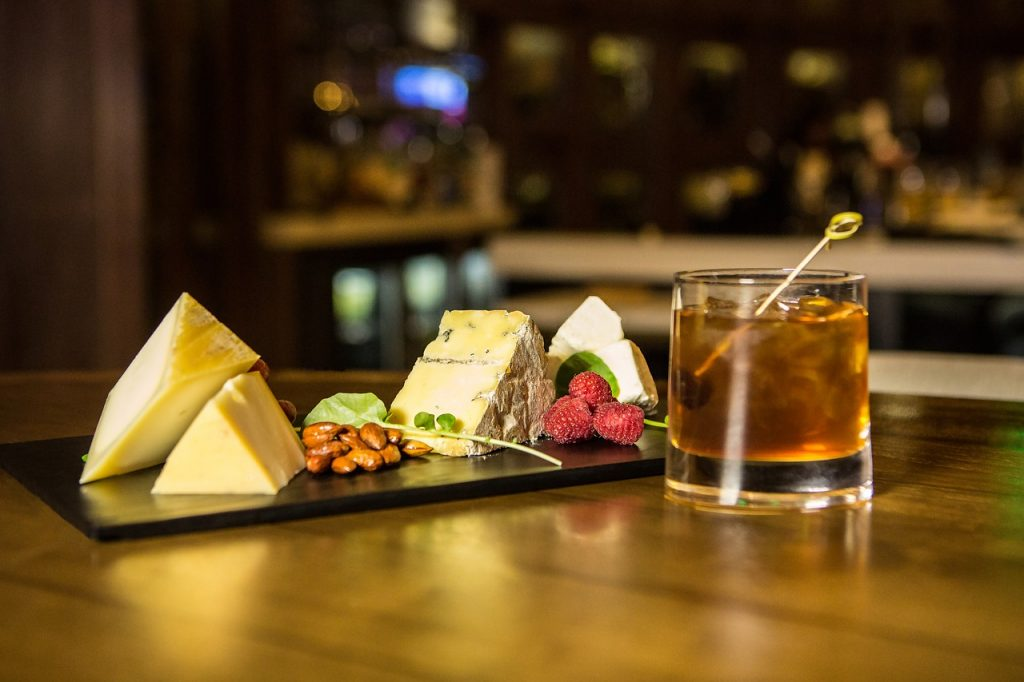 a cheese board with scotch whisky