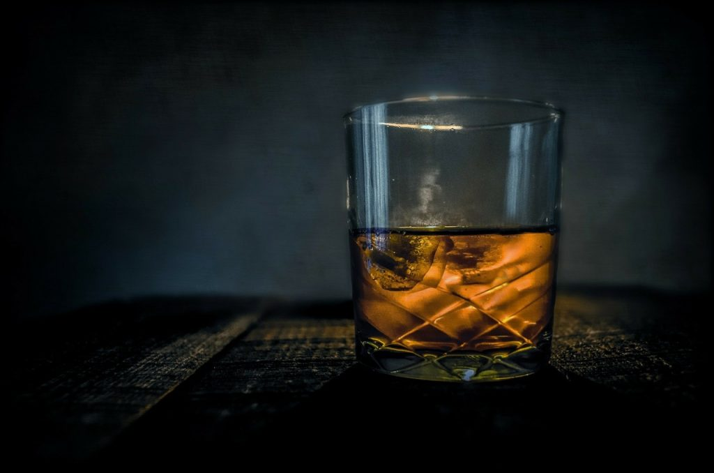 Whisky glass on table
