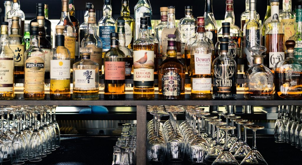 Collection of whisky behind a bar