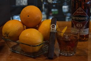 cigar next to an old fashioned