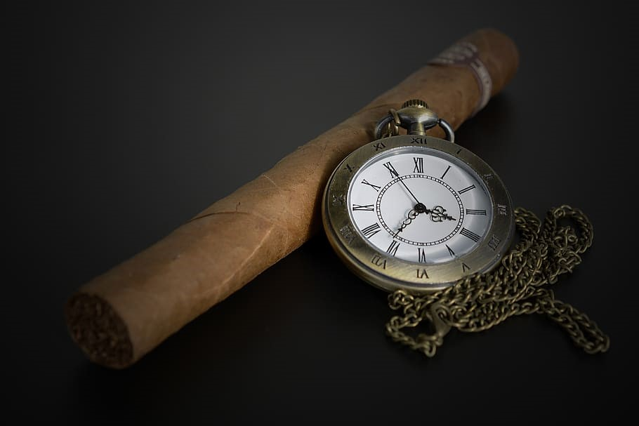 a cigar with a watch