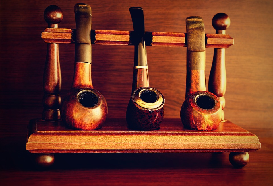Authentic traditional tobacco pipes on a wooden stand
