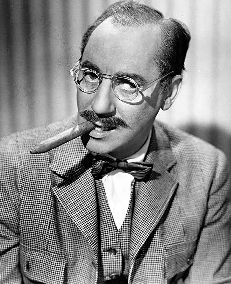 groucho marx smoking a cigar
