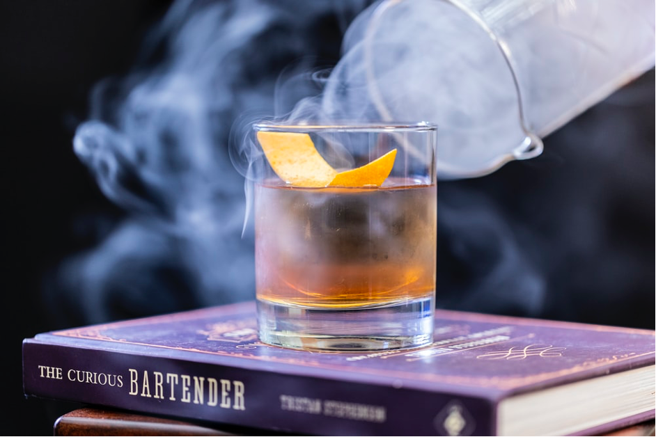 An Old Fashioned on top of a book