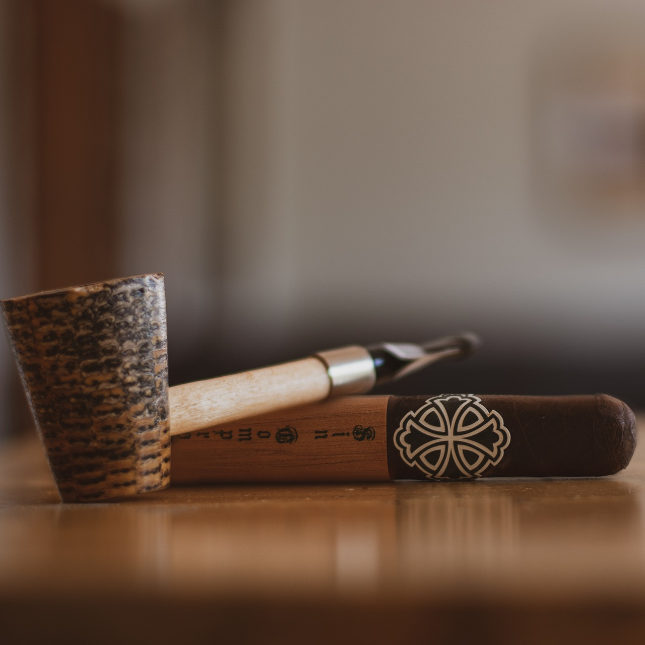 A smoking pipe resting on a cigar