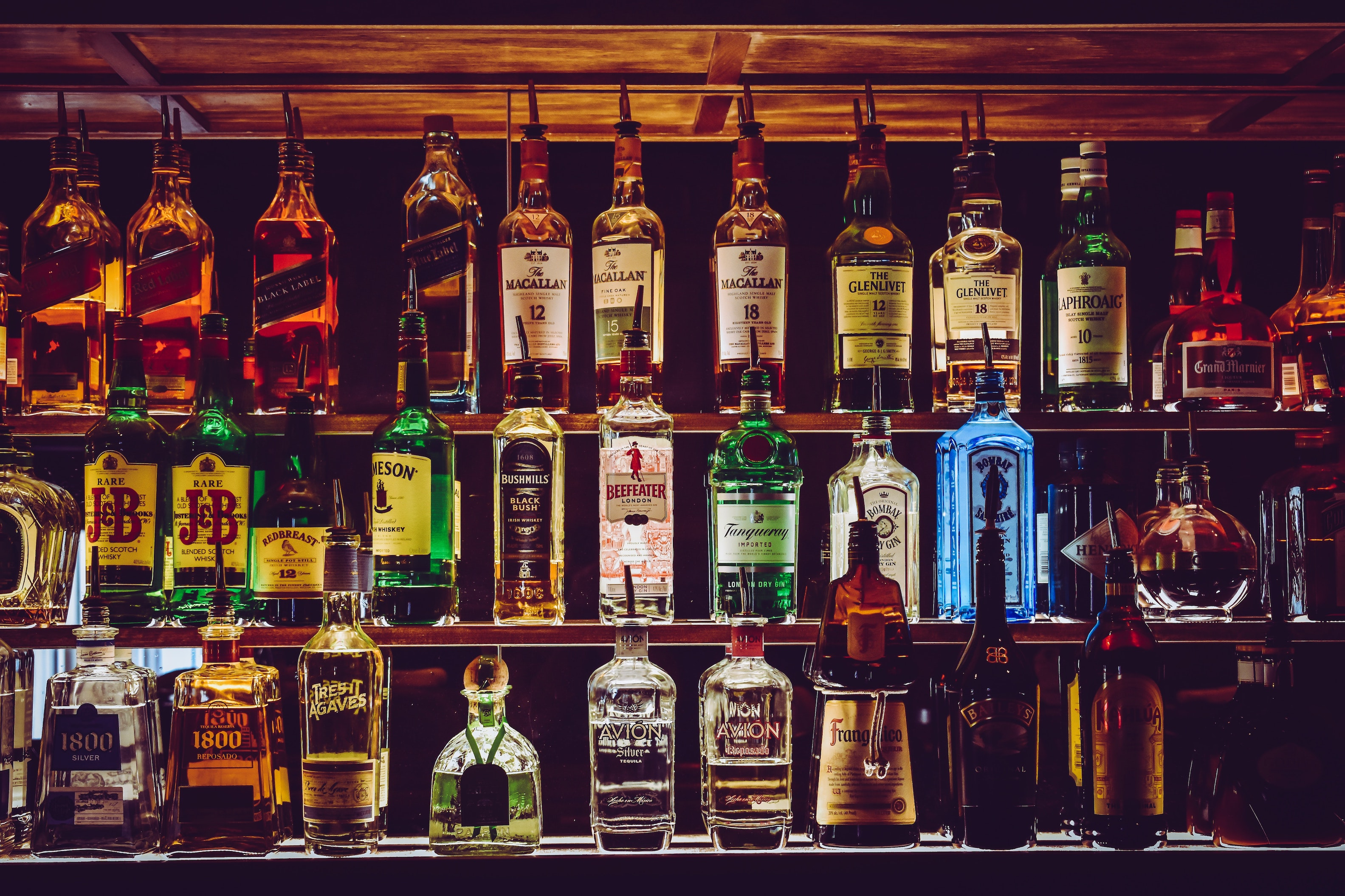 A selection of alcoholic drinks at the back of a bar