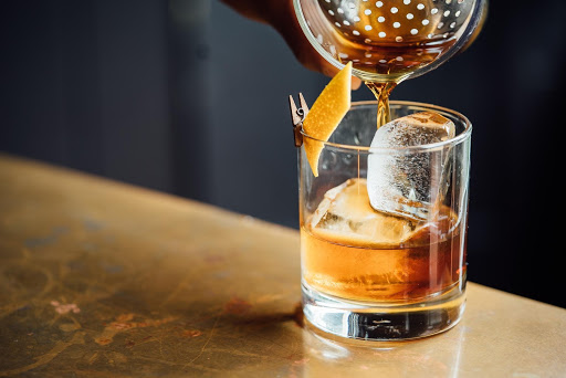 An old fashioned cocktail poured over ice