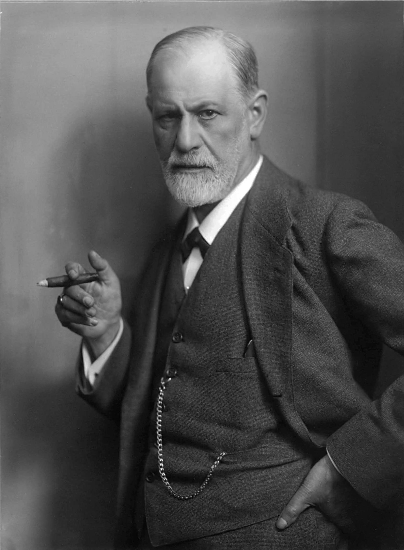 Sigmund Freud stood up smoking a cigar