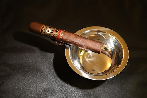 A semi box-pressed cigar on an ashtray
