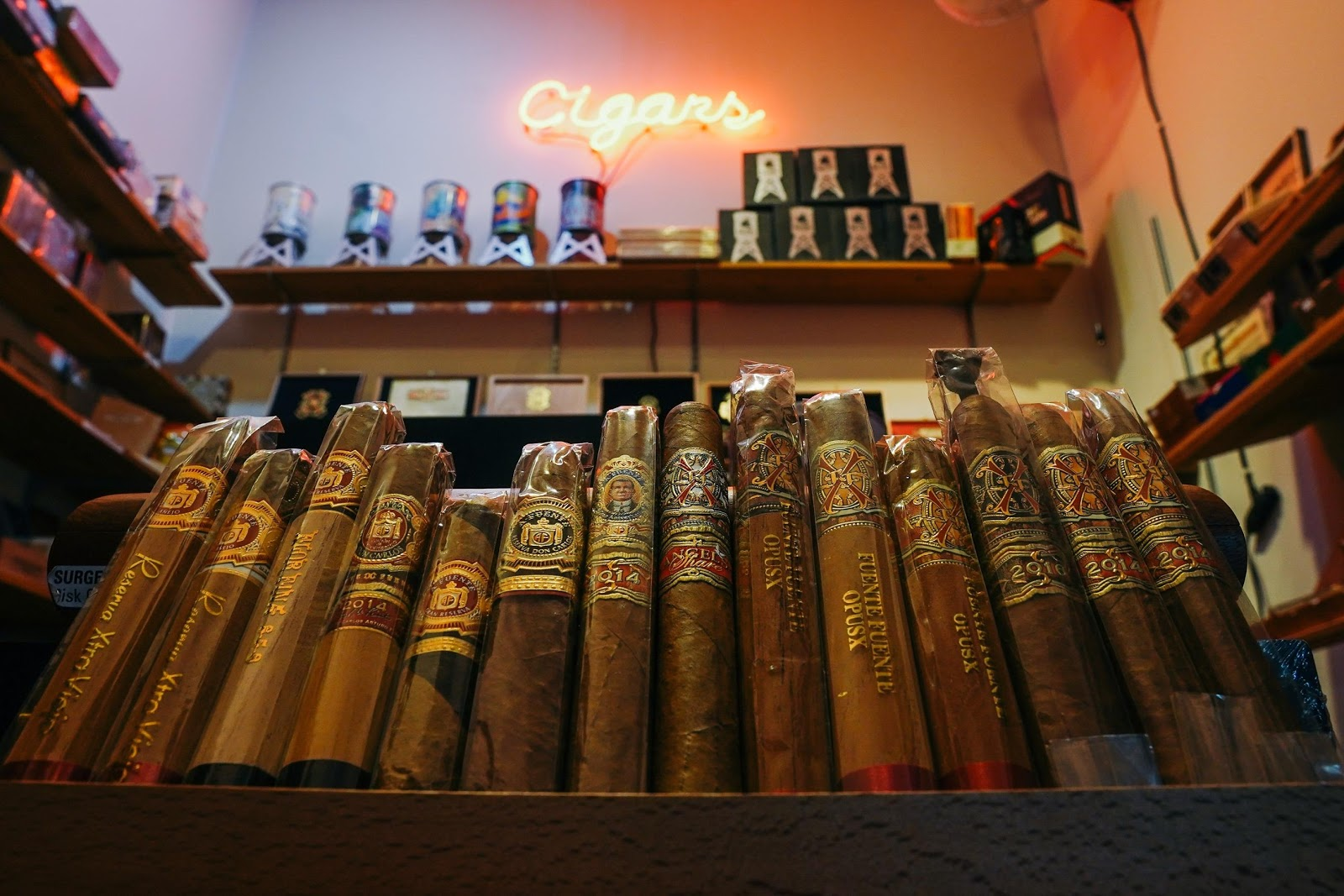 A cigar display in a line wrapped in cellophane