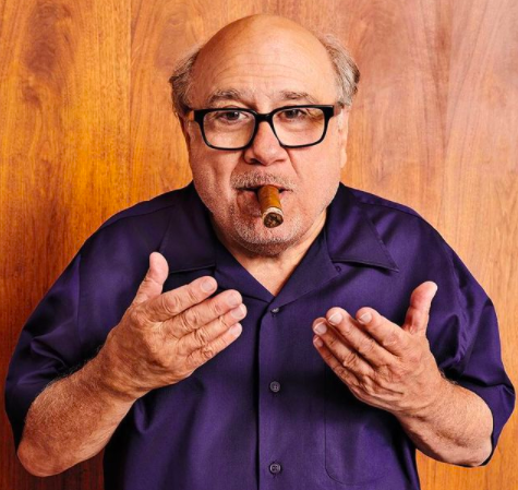 Danny DeVito with a cigar in his mouth