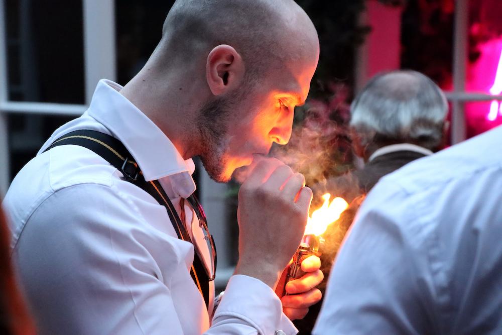 man lighting a cigar
