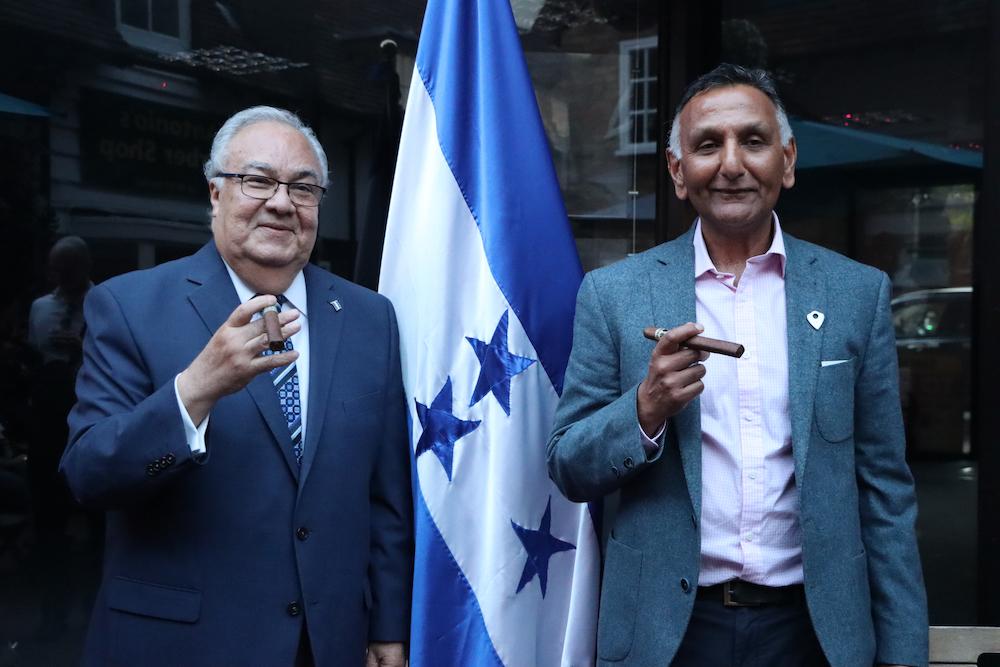 Ambassador of Honduras, H.E. Iván Romero Martínez and Paresh Patel holding cigars